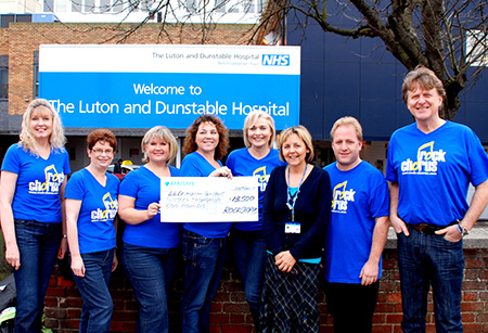 Members of Rock chorus present a cheque to the L & D Hospital